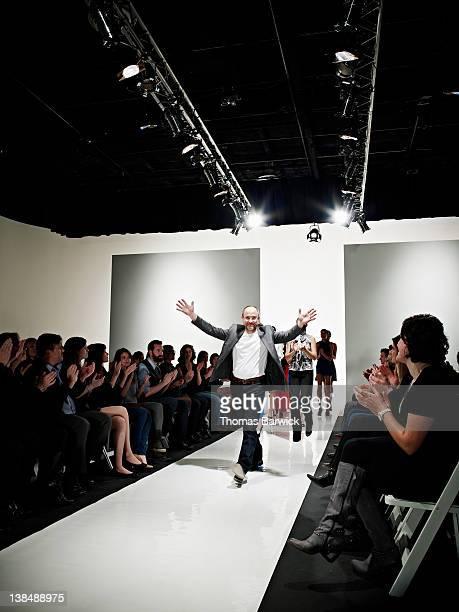 Designer walking down catwalk at end of show
