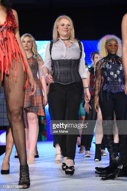 Designer walks the runway for Loch Dress at the House of iKons show during London Fashion Week February 2019 at the Millennium Gloucester London...