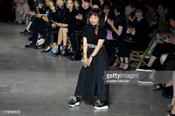 Designer Wang Chen TsaiHsia acknowledges the audience during the Shiatzychen Womenswear Spring/Summer 2020 show as part of Paris Fashion Week on...