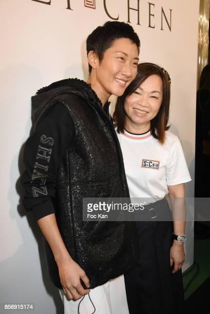Designer Wang Chen TsaiHsia from Schiatzy Chen and a guest attend the Schiatzy Chen show as part of the Paris Fashion Week Womenswear Spring/Summer...