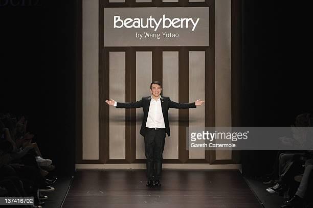 Designer Wang Yutao on the runway at the Beautyberry by Wang Yutao Autumn/Winter 2012 fashion show during MercedesBenz Fashion Week Berlin at...