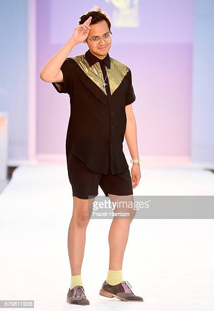 Designer Wilber Tellez walks the runway at Filthy Haanz 2017 Collection during SwimMiami at The W Hotel South Beach on July 17 2016 in Miami Florida