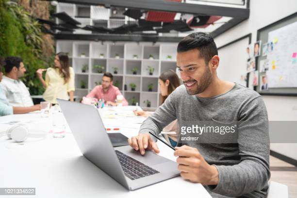 Designer working at a creative office using a laptop computer