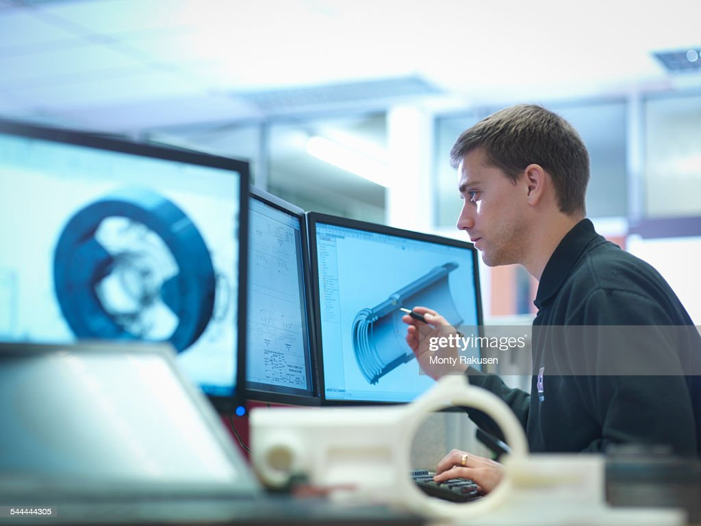 CAD designer working on engineering designs : Stock Photo