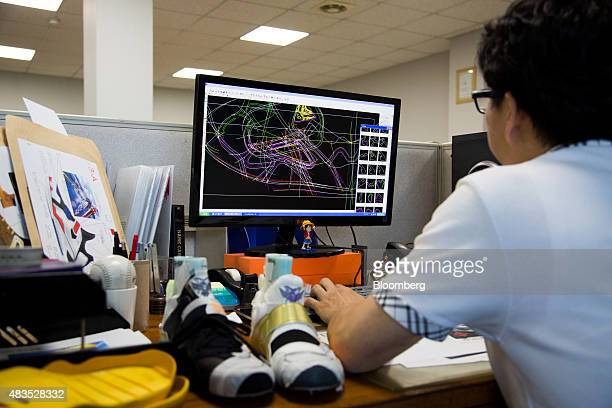 A designer works in front of a computer at the Haksan Ltd shoe factory in Busan South Korea on Thursday July 30 2015 South Korea's manufacturing...