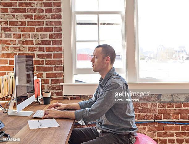 Designer works on laptop