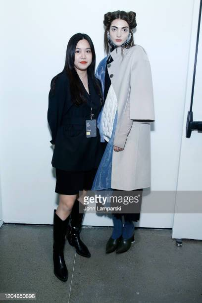 Designer Yalan Li and a model pose at the Blancore fashion show during February 2020 New York Fashion Week The Shows at Gallery II at Spring Studios...