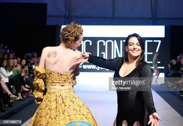 Designer Yas Gonzalez walks the runway with a model at Vancouver Fashion Week Spring/Summer 19 Day 4 on September 20 2018 in Vancouver Canada