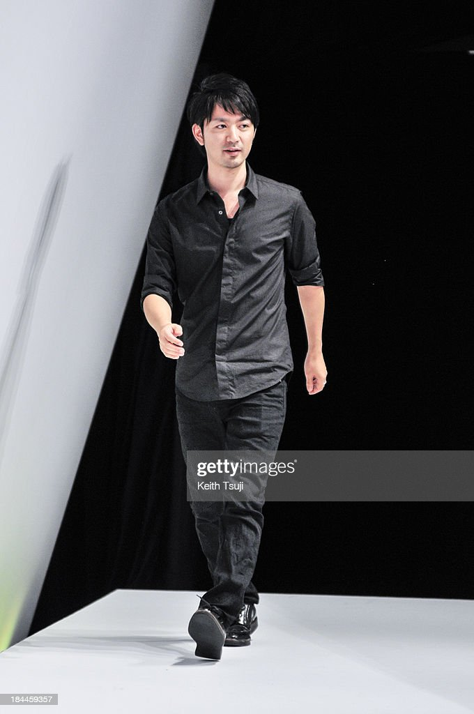 Designer Yasutoshi Ezumi on the runway during the Yasutoshi Ezumi show as part of Mercedes Benz Fashion Week Tokyo S/S 2014 at Hikarie Hall B of Shibuya Hikarie on October 14, 2013 in Tokyo, Japan.