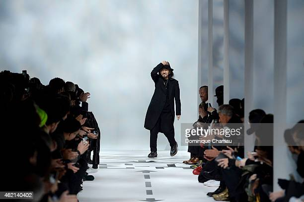 Designer Yohji Yamamoto acknowledges the applause of the audience after the Y3 Menswear Fall/Winter 20152016 show as part of Paris Fashion Week on...