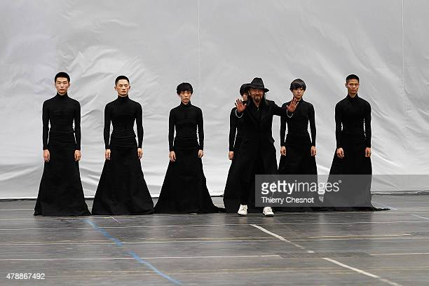 Designer Yohji Yamamoto and dancers stand on the runway during the Y3 Menswear Spring/Summer 2016 show as part of Paris Fashion Week on June 28, 2015...