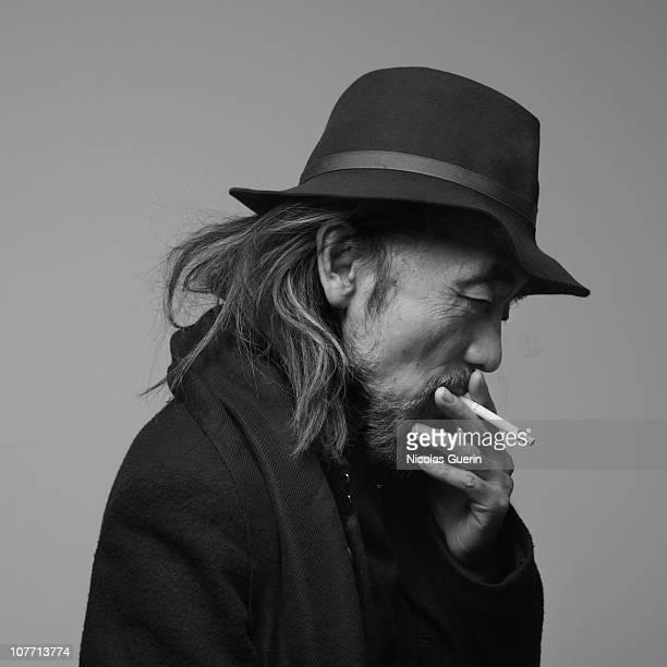 Designer Yohji Yamamoto poses at a portrait session in Paris 2010