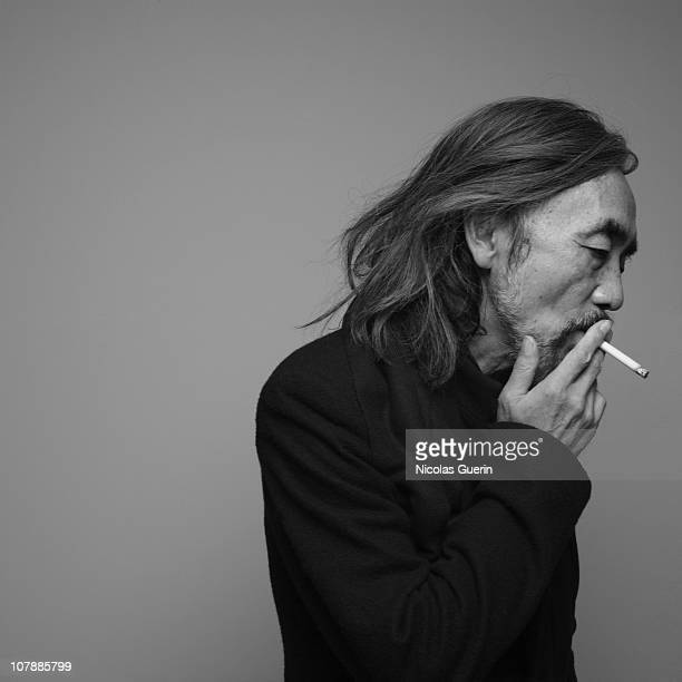 Designer Yohji Yamamoto poses at a portrait session in Paris. 2010.