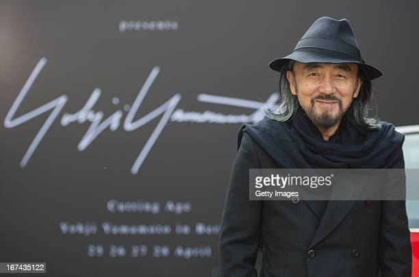 Designer Yohji Yamamoto poses during a photocall prior his first fashion show 'Cutting Age' in Germany at St. Agnes Church on April 25, 2013 in...