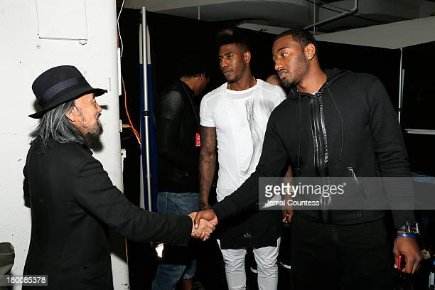 Designer Yohji Yamamoto speaks with NBA players Iman Shumpert and John Wall backstage at the Y-3 Spring/Summer 2014 show during Mercedes-Benz Fashion...