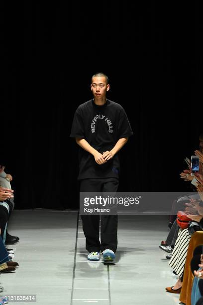 Designer Yoshiki Hanzawa greets on the runway during the PERMINUTE show as part of Amazon Fashion Week TOKYO 2019 A/W at Shibuya Hikarie Hall on...