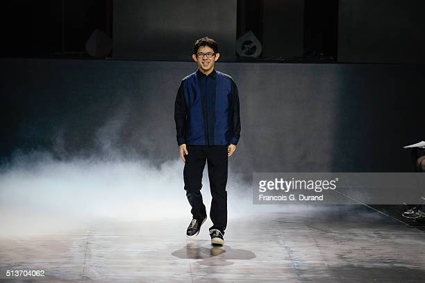 Designer Yoshiyuki Miyamae ackowledges the applause of the public after his show as part of the Paris Fashion Week Womenswear Fall/Winter 2016/2017...