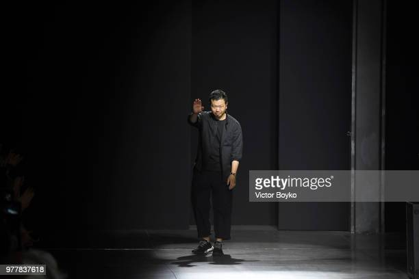 Designer Yosuke Aizawa acknowledges the applause of the audience at the Hunting World show during Milan Men's Fashion Week Spring/Summer 2019 on June...