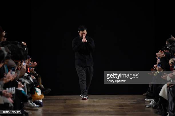 Designer Yosuke Aizawa acknowledges the audience during the White Mountaineering Menswear Fall/Winter 20192020 show as part of Paris Fashion Week on...