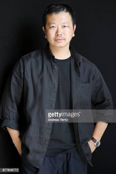 Designer Yosuke Aizawa poses backstage ahead of the Hunting World show during Milan Men's Fashion Week Spring/Summer 2019 on June 18 2018 in Milan...