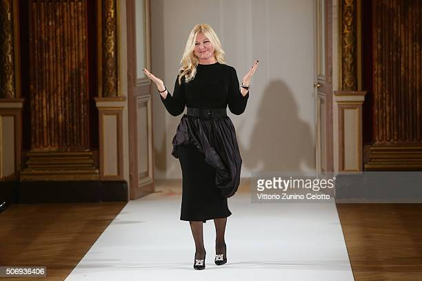 Designer Yulia Yanina acknowledges the applause of the public after the Yanina Couture Spring Summer 2016 show as part of Paris Fashion Week on...