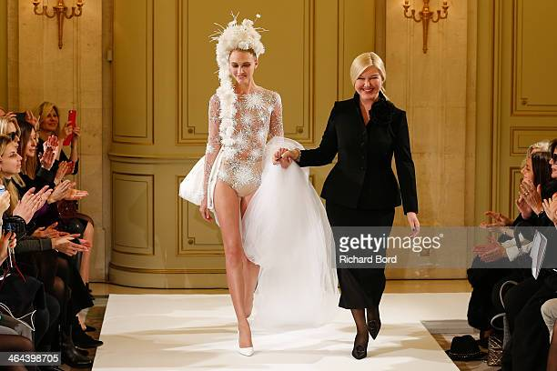 Designer Yulia Yanina and a model walk the runway after the Yulia Yanina show as part of Paris Fashion Week Haute Couture Spring/Summer 2014 at Hotel...
