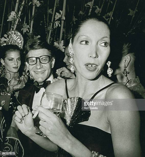 Designer Yves St Laurent and model Marina Schiano attending Opium Perfume Party on September 20 1978 aboard the boat Peking in New York City New York