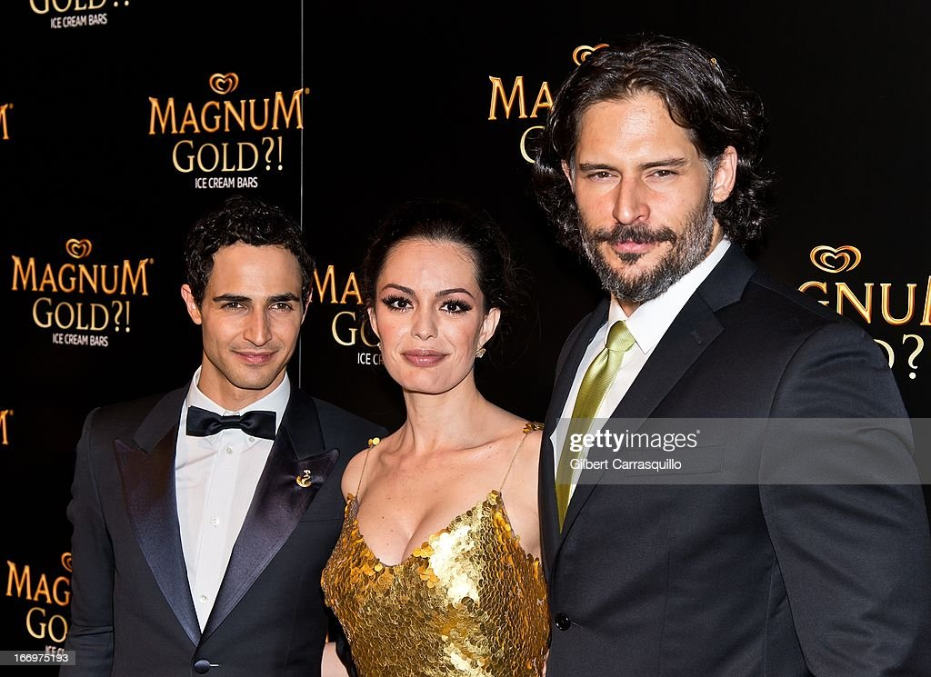 Designer Zac Posen, actress Caroline Correa wearing a Zac Posen one-of-a-kind 24k gold dress valued at $1.5 million and actor Joe Manganiello attend the premiere of 'As Good As Gold' during the 2013 Tribeca Film Festival at Gotham Hall on April 18, 2013 in New York City.