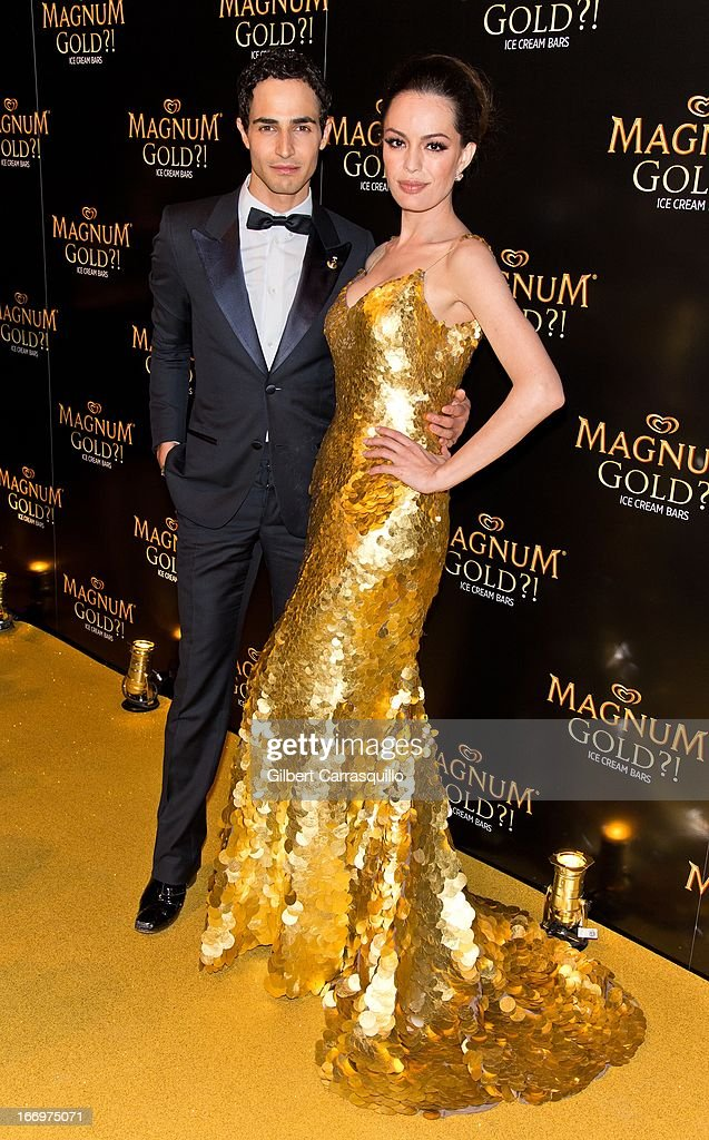 Designer Zac Posen and actress Caroline Correa wearing a Zac Posen one-of-a-kind 24k gold dress valued at $1.5 million attend the premiere of 'As Good As Gold' during the 2013 Tribeca Film Festival at Gotham Hall on April 18, 2013 in New York City.