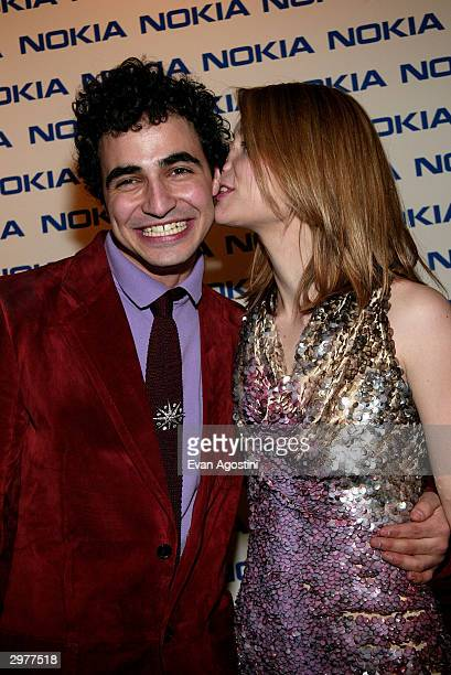 Designer Zac Posen and actress Claire Danes pose backstage at the Zac Posen fashion show during Olympus Fashion Week at Bryant Park February 12 2004...