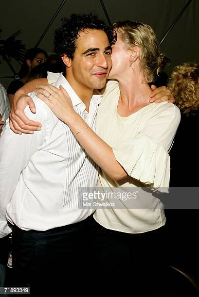 Designer Zac Posen and actress Gretchen Mol kiss at the Zac Posen Spring 2007 after party at the Soho Grand Dome during Olympus Fashion Week...