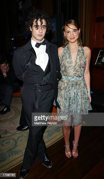 Designer Zac Posen and actress Natalie Portman pose at a New Year's Eve party hosted by Portman and singer Britney Spears at Ian Schrager's Hudson...
