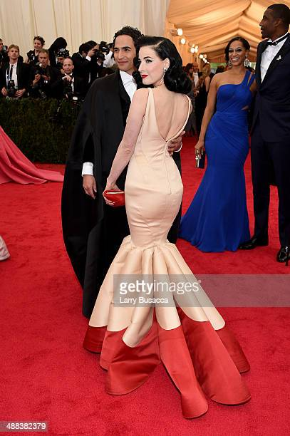 "Designer Zac Posen and Dita Von Teese attend the ""Charles James: Beyond Fashion"" Costume Institute Gala at the Metropolitan Museum of Art on May 5,..."