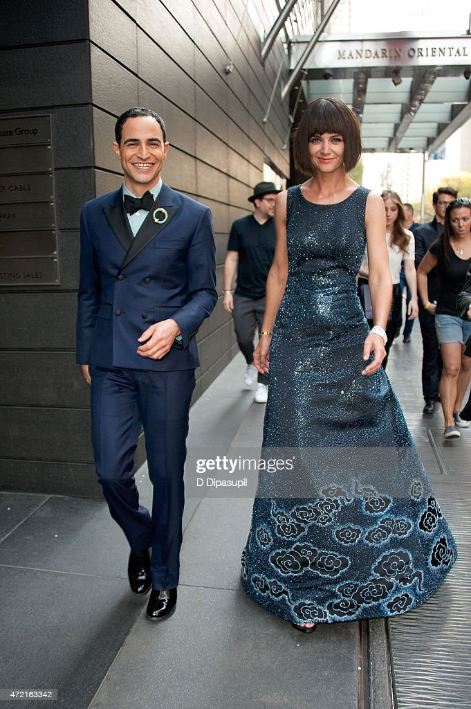 Designer Zac Posen (L) and Katie Holmes are seen departing the Mandarin Oriental hotel on May 4, 2015 in New York City.