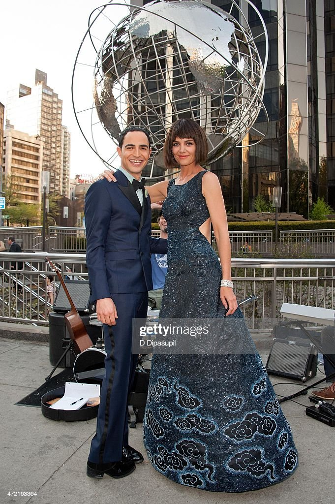 Designer Zac Posen (L) and Katie Holmes pose on the streets of Manhattan before heading to the Costume Institute Benefit Gala on May 4, 2015 in New York City.
