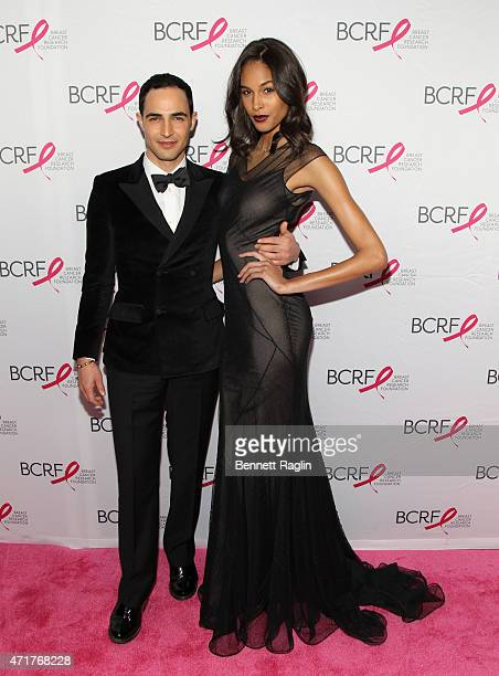 Designer Zac Posen and model Cindy Bruna attend The Breast Cancer Research Foundation 2015 Pink Carpet Party at The Waldorf=Astoria on April 30 2015...