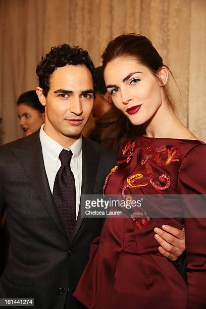 Designer Zac Posen and model Hilary Rhoda prepare backstage at the Zac Posen Fall 2013 fashion show during MercedesBenz Fashion Week on February 10...