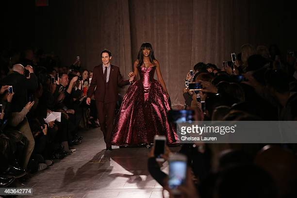 Designer Zac Posen and model Naomi Campbell walk the runway during the Zac Posen fashion show at Vanderbilt Hall at Grand Central Terminal on...