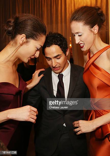 Designer Zac Posen and models pose backstage at the Zac Posen Fall 2013 fashion show during MercedesBenz Fashion Week on February 10 2013 in New York...