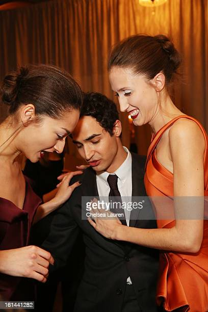Designer Zac Posen and models prepare backstage at the Zac Posen Fall 2013 fashion show during MercedesBenz Fashion Week on February 10 2013 in New...