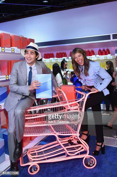 Designer Zac Posen and Nina Garcia pose in the grocery store inspired presentation space during the Esmara By Heidi Klum Lidl Fashion Presentation at...