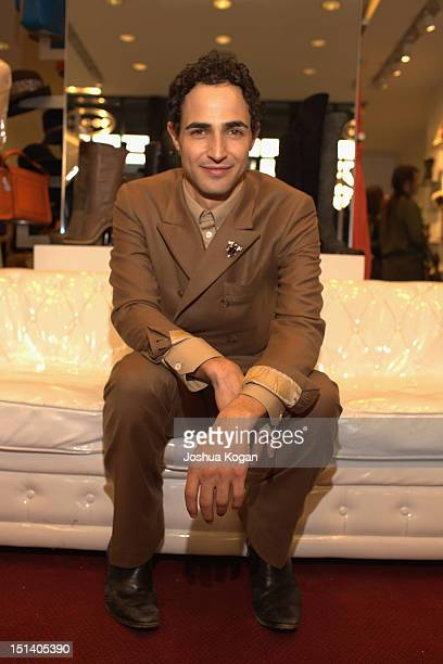 Designer Zac Posen attends Fashion's Night Out Scoop NYC AG Jeans And Tequila Avion Present St Lucia on September 6 2012 in New York City
