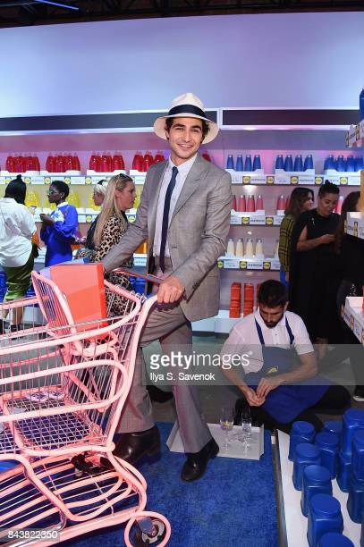 Designer Zac Posen poses in the grocery store inspired presentation space during the Esmara By Heidi Klum Lidl Fashion Presentation at New York...