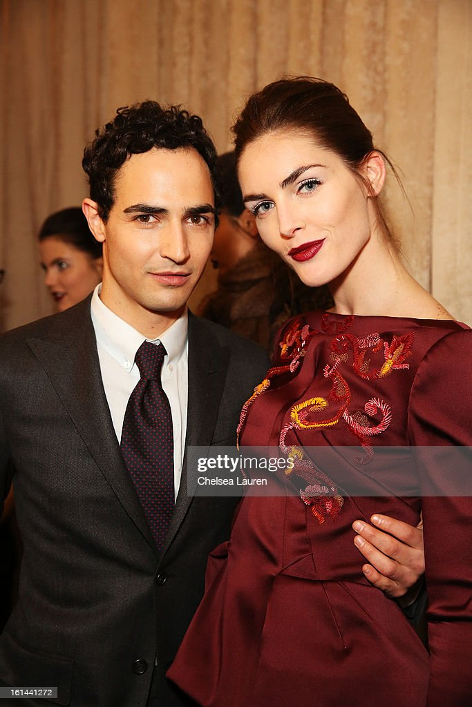 Designer Zac Posen poses with model Hilary Rhoda backstage at the Zac Posen Fall 2013 fashion show during Mercedes-Benz Fashion Week on February 10, 2013 in New York City.