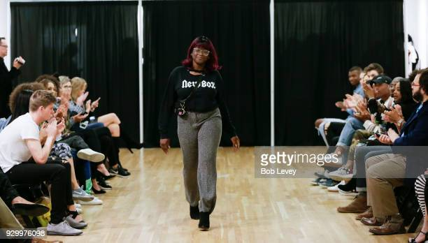 Designer Zainab Olagunju New Box receives applause from the crowd after showing her designs during the Fresh Off The Rail Streetwear Fashion Week Day...