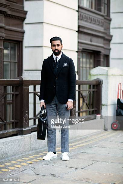 Designer Zak Timol wears a dark blue Velsvoir blazer layered over a sports jacket a gray Velsvoir cropped wool pleated trousers white sneakers and a...