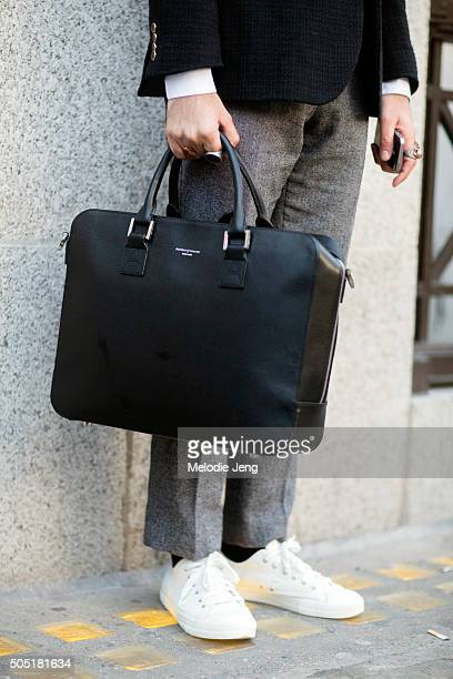 Designer Zak Timol wears a gray Velsvoir cropped wool pleated trousers white sneakers and a black Aspinal of London leather briefcase during The...