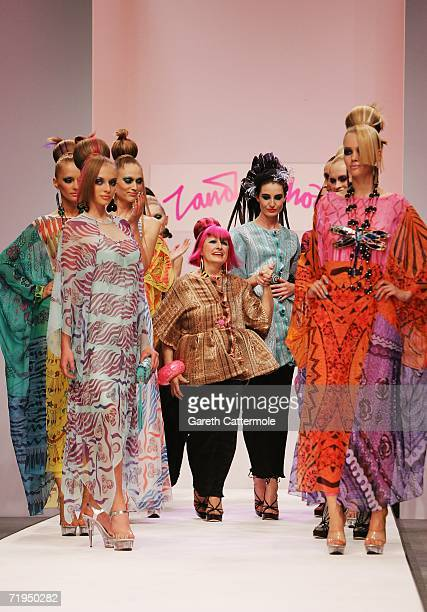 Designer Zandra Rhodes and model Erin O'Connor flanked by other models walk down the catwalk at the end of the Zandra Rhodes Fashion show part of...