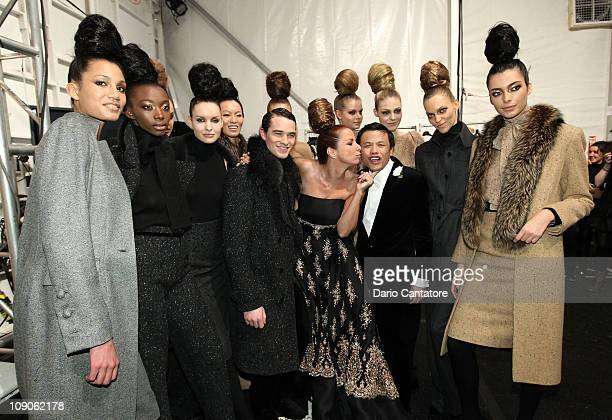 Designer Zang Toi and Jill Zarin of the Real Housewives of New York pose backstage with models at the Zang Toi Fall 2011 fashion show during...
