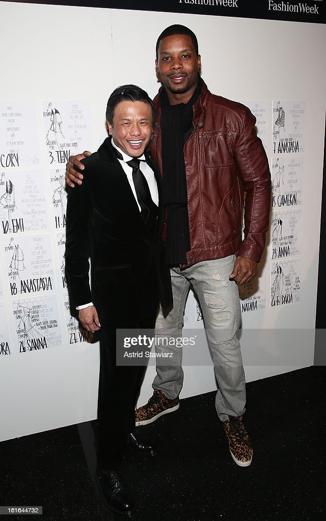 Designer Zang Toi and NFL safety Kerry Rhodes backstage at the Zang Toi Fall 2013 fashion show during Mercedes-Benz Fashion Week at The Stage at Lincoln Center on February 13, 2013 in New York City.